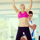 trainer support young woman while lifting on bar in fitness gym - PhotoDune Item for Sale