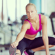 woman stretching and warming up for her training at a gym - PhotoDune Item for Sale