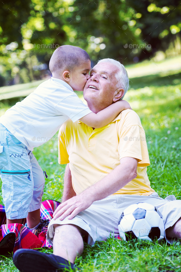 grandfather and child have fun  in park - Stock Photo - Images