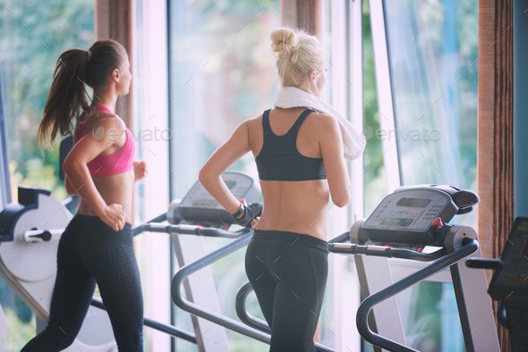 woman exercising on treadmill in gym - Stock Photo - Images