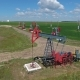 Flying Over Working Oil Pumps at Sunny Day - VideoHive Item for Sale