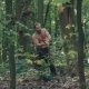 Strong Forester Hacking a Tree in a Forest. Slowly - VideoHive Item for Sale