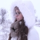 Portrait of Lovely Female Spectacled Standing under Snowfall in Winter - VideoHive Item for Sale