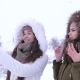 Girlfriends Make an Air Kiss for Photos on Gadget in Winter Time - VideoHive Item for Sale