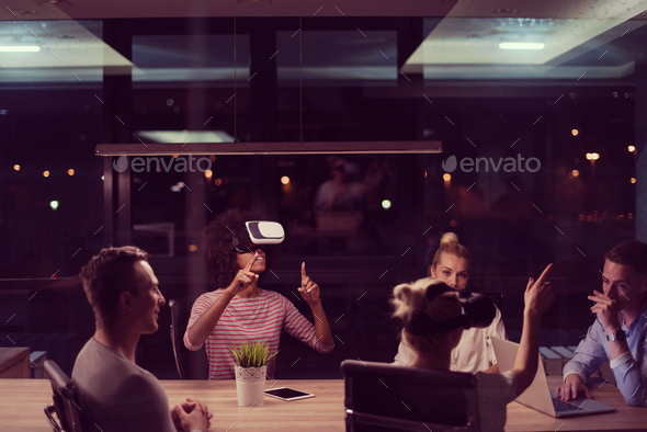 Multiethnic Business team using virtual reality headset - Stock Photo - Images