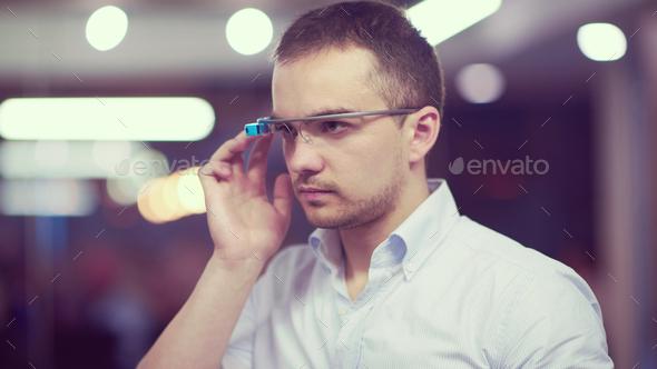 man using virtual reality gadget computer glasses - Stock Photo - Images