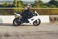Woman biker driving a motorbike on a road - PhotoDune Item for Sale