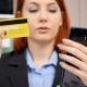 Businesswoman Looking at Her Credit Card and Introducing the Data on the Smartphone - VideoHive Item for Sale