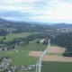 Aerial Footage of a Village and a Road between Green Fields and Forests on Sunset - VideoHive Item for Sale