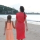 Young Beautiful Mother and Her Adorable Little Daughter Have Fun at Tropical Beach - VideoHive Item for Sale