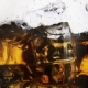 Whiskey in a Glass with Ice on a Light Background - VideoHive Item for Sale