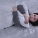 Top Shot Young Sad Asian Girl Lying on the Bed, Hugging a Pillow, Unhappy - VideoHive Item for Sale