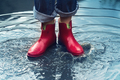 woman with red short boots standing in a puddle of rain water - PhotoDune Item for Sale