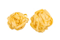 two balls of tagliatelle pasta isolated on white - PhotoDune Item for Sale