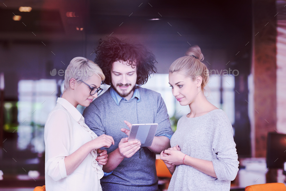group of Business People Working With Tablet in startup office - Stock Photo - Images