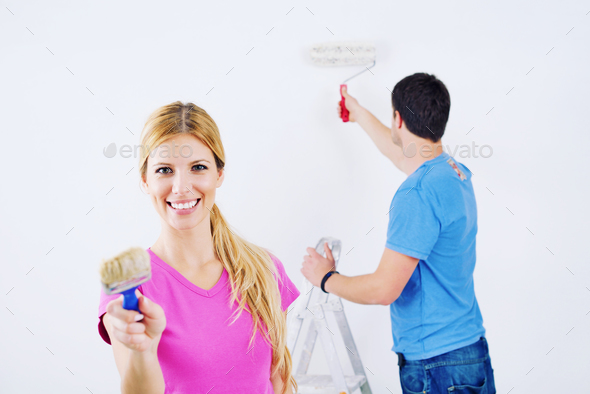 happy couple paint wall at new home Stock Photo by dotshock | PhotoDune