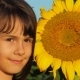 Little Girl with a Big Sunflower - VideoHive Item for Sale