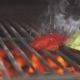 A Chef with Gloves Frying Vegetables on a Grill - VideoHive Item for Sale