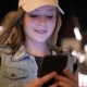 Attractive Teenage Girl Using a Mobile Phone while Walking the Streets in a Night City - VideoHive Item for Sale