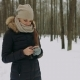 Beautiful Smiling Young Woman Using Mobile in the Winter Park - VideoHive Item for Sale