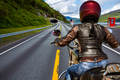 Biker girl First-person view, mountain serpentine. - PhotoDune Item for Sale