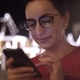 Attractive Woman Using a Mobile Phone While Walking Through the Streets in a Night City - VideoHive Item for Sale