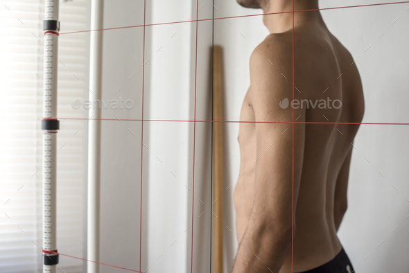 orthopedic physiotherapist check body growth of young athlete - Stock Photo - Images