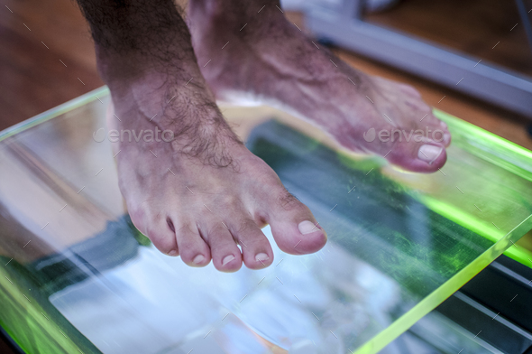 posture and equilibrium analysis by foot step scanning - Stock Photo - Images
