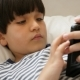 Kid Playing with Smartphone - VideoHive Item for Sale