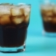 Refocusing Glass of Cola on a Blue Background - VideoHive Item for Sale