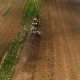 Aerial Footage of a Tractor on a Field. - VideoHive Item for Sale