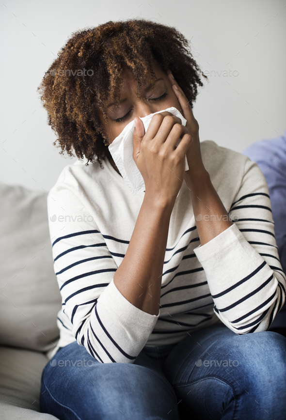 Woman sick and sneezing - Stock Photo - Images