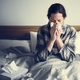 A woman suffering from flu in bed - PhotoDune Item for Sale