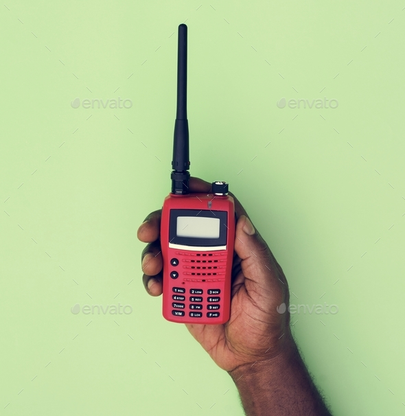 Hand holding walkie-talkie isolated on background - Stock Photo - Images