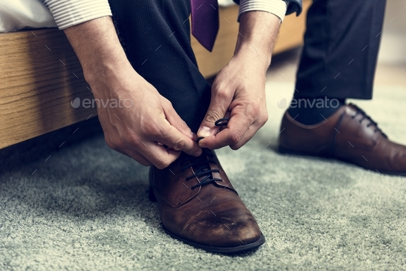 A man tying shoe lace - Stock Photo - Images