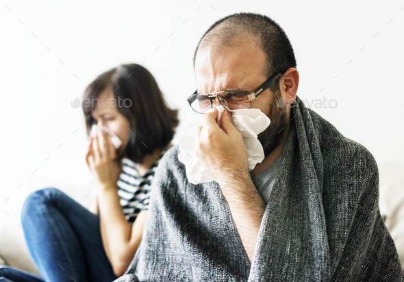 Couple sick together at home - Stock Photo - Images