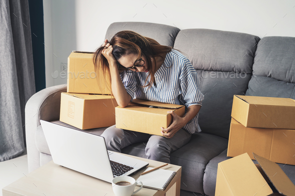 Stressed and frustrated asian business woman holding head in hands - Stock Photo - Images