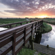 wooden bridge for bicycles via river at sunrise - PhotoDune Item for Sale