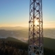 Flying over Radio Tower in Snow Covered Winter Mountain Landscape - VideoHive Item for Sale