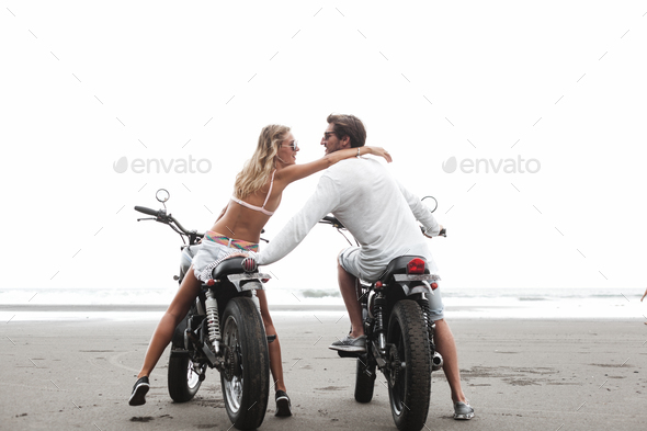 Young beautiful couple on motorcycles - Stock Photo - Images