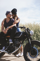handsome young man and woman travelling together on motorbike - PhotoDune Item for Sale