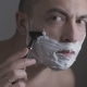 Man Shaving His Face with a Razor with the Help of a Special Foam - VideoHive Item for Sale