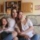 Portrait of Two Sisters and a Little Girl on Couch - VideoHive Item for Sale