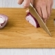 Slicing Onion on Wooden Cutting Board - VideoHive Item for Sale