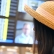 Young Mixed Race Tourist Woman Looking for Her Flight Status on the Schedule Board and Checking Time - VideoHive Item for Sale