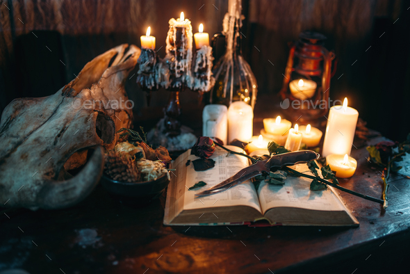 Witchcraft, dark magic, candles with ritual book - Stock Photo - Images