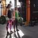 Team of Two Fitness Women Doing Deadlift Exercise Together in Gym - VideoHive Item for Sale