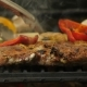 The Chef Turns the Grilled Pepper Vegetables Into Sliced Peppers, Tomatoes, Mushrooms, Zucchini - VideoHive Item for Sale