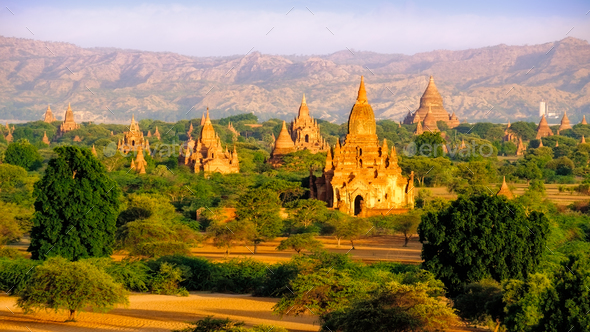 Sunrise landscape view of beautiful old temples in Bagan, Myanmar - Stock Photo - Images