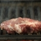 Chef Throws a Piece of Meat on the Grill for Cooking - VideoHive Item for Sale
